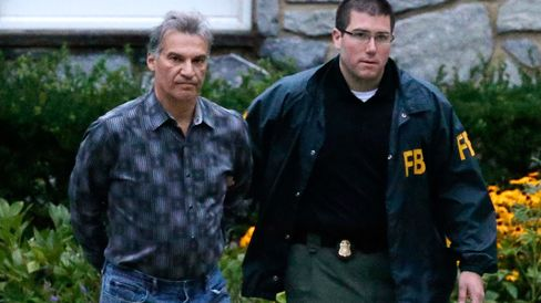 Vitaly Korchevsky, who regulators say made $17.5 million in illicit profits, is escorted by FBl Agents from his home in Glen Mills, Pennsylvania on Tuesday, Aug. 11, 2015.