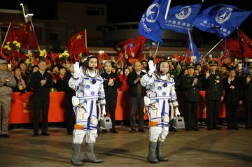 Astronauts Jin Haipeng and Chen Dong prior to the launch of the Shenzhou-11 spacecraft on Oct. 17. Photographer: How Hwee Young/EPA