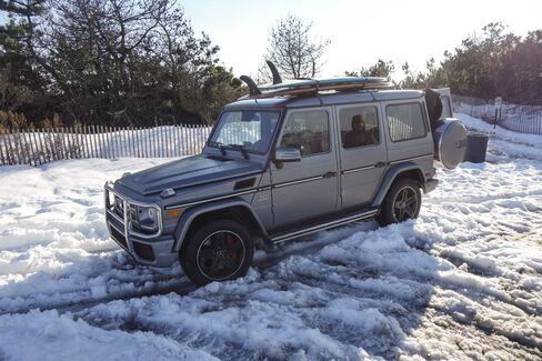 Mercedes G Wagon, driven through snow.