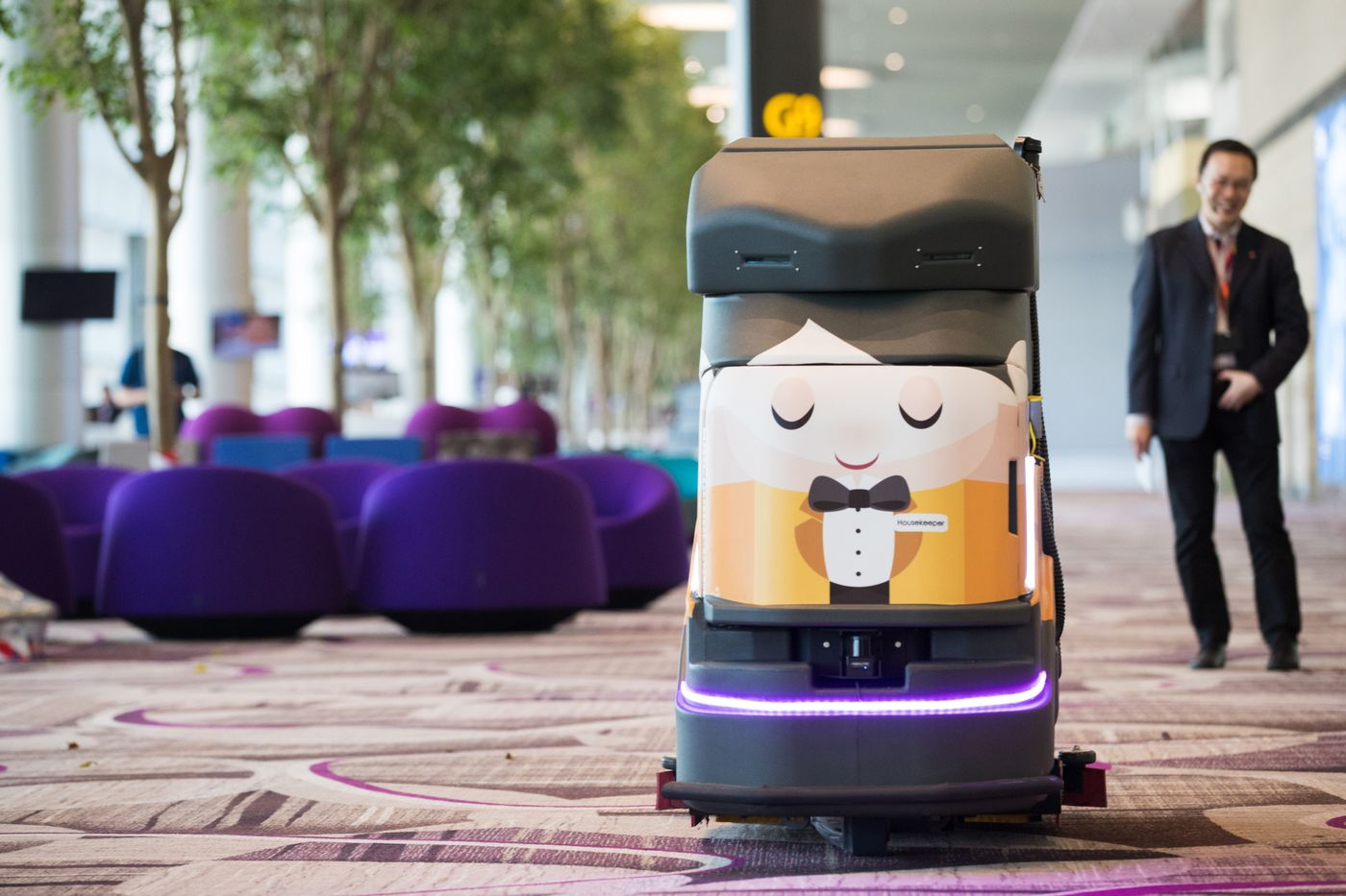 An robotic cleaner in the departure hall of Terminal 4 at Changi Airport. Photographer: Nicky Loh/Bloomberg