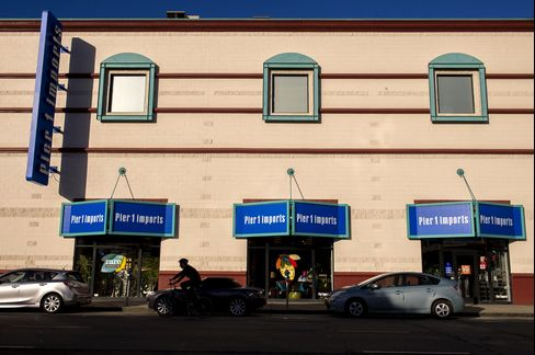 A Cyclist Rides Past a Pier 1 Imports Store in San Francisco