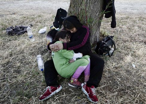 A Syrian mother holds her daughter after arriving on the Greek Island of Lesbos.