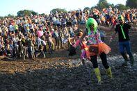 Beyonce Rocks, Bono Faces Demo, 180,000 Fans Get Muddy