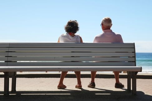 A couple sits on a bench at Manly beach in Sydney, Australia, on Wednesday, April 1, 2015. The number of people aged 65 and over is expected to double by 2055.