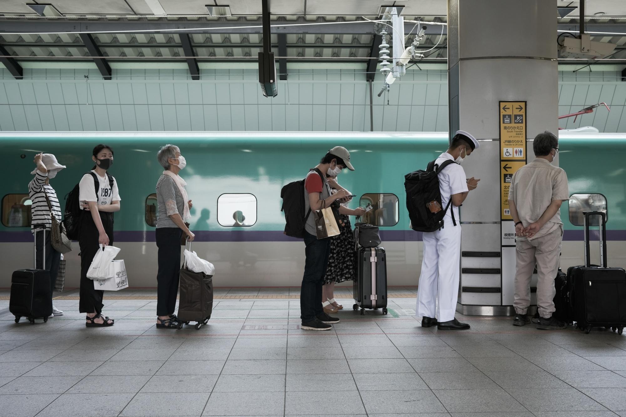 Travelers at Tokyo Station Ahead of Obon-holiday Week