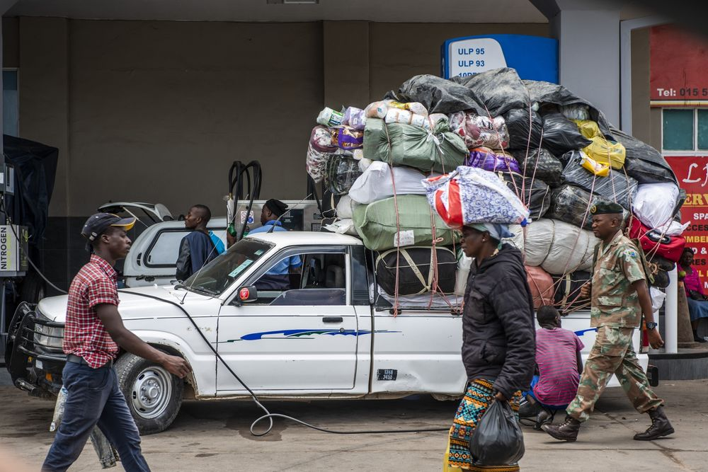 A delivery driver fills a truck loaded with goods at a gas station near the border crossing with Zimbabwe, near Musina, South Africa.
