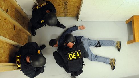 U.S. Drug Enforcement Administration (DEA) Agents simulate a raid in their Tactical Training Facility at the DEA Training Academy in Quantico, Virginia.