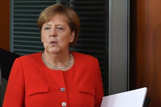 Merkel Fails to End Coalition Rift on Migrants Ahead of EU Talks