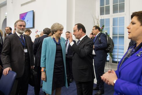 Francois Hollande speaks to Theresa May on Feb. 3.