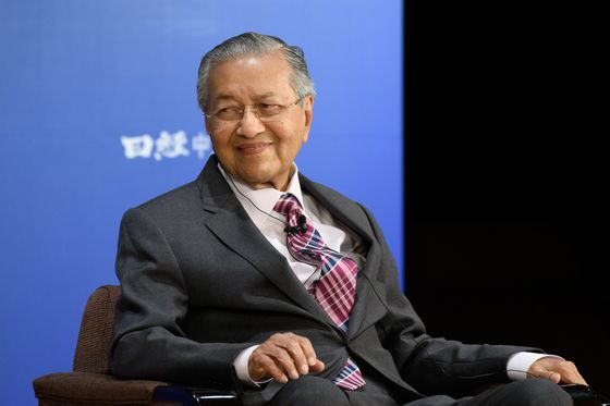 Mahathir Worries About Job Losses on Merger with Malaysia's Biggest Wireless Carrier