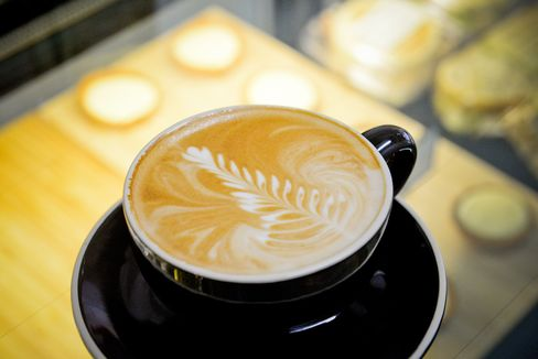 A cup of flat white is prepared at the Barista Basics training school in Sydney. Photographer: Jeremy Piper/Bloomberg