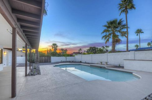 The pool may be prettier than this Phoenix home's barn doors, but the latter design feature is in higher demand.