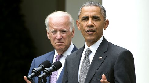 President Barack Obama with Vice President Joe Biden about the Supreme Court's ruling to uphold the subsidies that comprise the Affordable Care Act, known as Obamacare, in the Rose Garden of the White House in Washington, DC, on June 25, 2015.