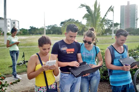 Cubans use the Wi-Fi coming from the Hotel Pernik in Holguin, Cuba.