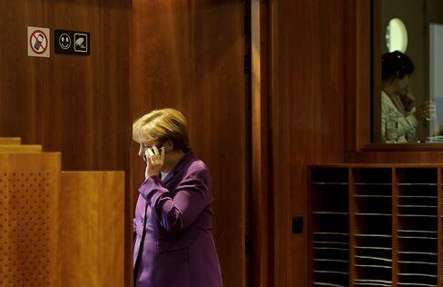 Chancellor Angela Merkel on her Mobile Phone
