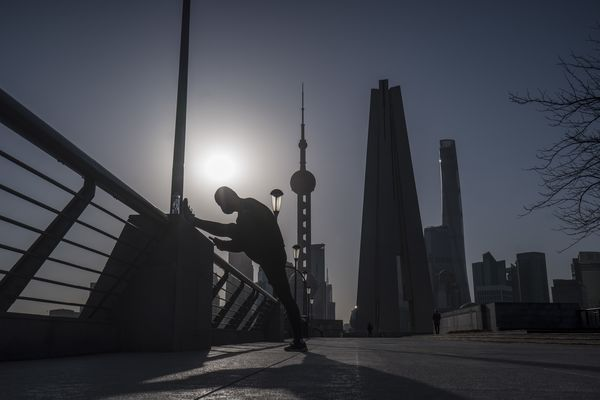Office Workers in Shanghai as Premier Says Most of China Is Returning to Normal