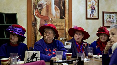Members of the Red Hat Society listen as Rick Santorum speaks at a Pizza Ranch restaurant in Mason City, Iowa, on Jan. 27, 2016.
