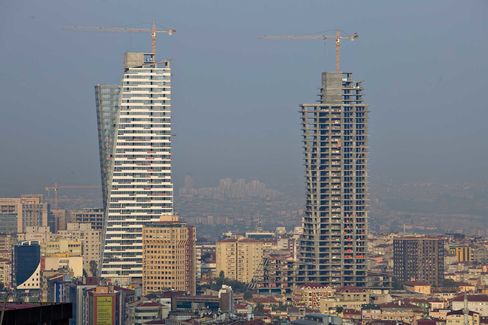Construction cranes stand above Trump Towers Istanbul in Istanbul, Turkey.