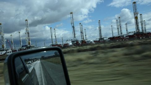Near the interstate exit to Odessa, Tex., dozens of stagnant oil rigs are clustered together. Each idle rig means hundreds of people aren't working.