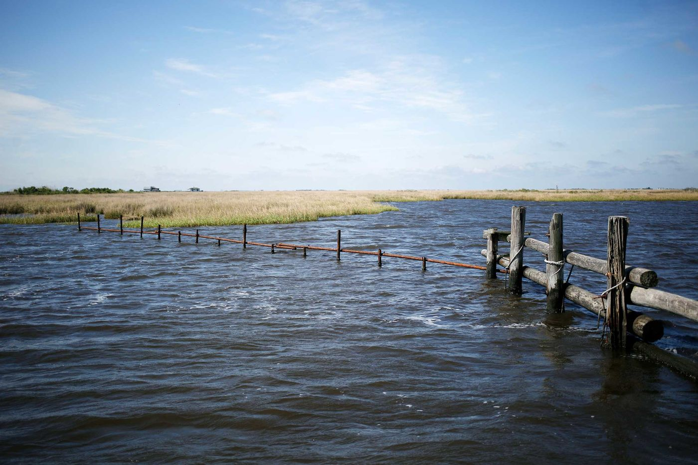 Public access to this waterway near Grand Isle is hindered by a private property owner's fence.