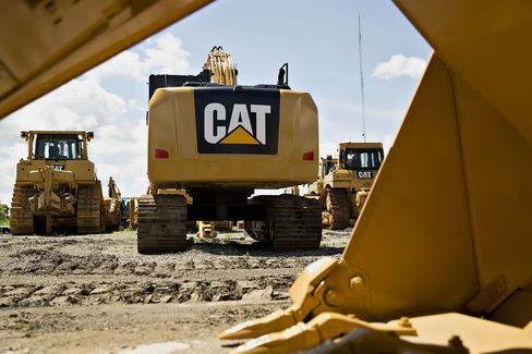 A Caterpillar Inc. excavator sits outside the Altorfer Cat dealership in East Peoria, Illinois.