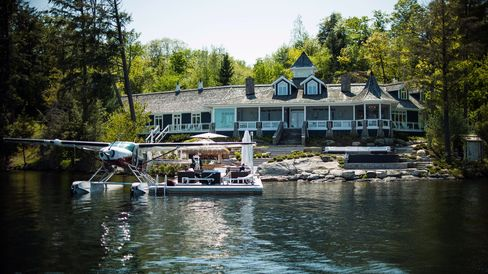A floatplane parked along the dock of David Cynamon's cottage on Lake Joseph in Muskoka. Photographer: James MacDonald/Bloomberg