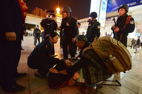 After Train Station Massacre Labeled 'China's 9/11,' a Wide Search for Culprits