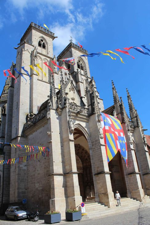 The cathedral at the heart of Semur-en-Auxois is festooned with banners heralding an early summer festival.