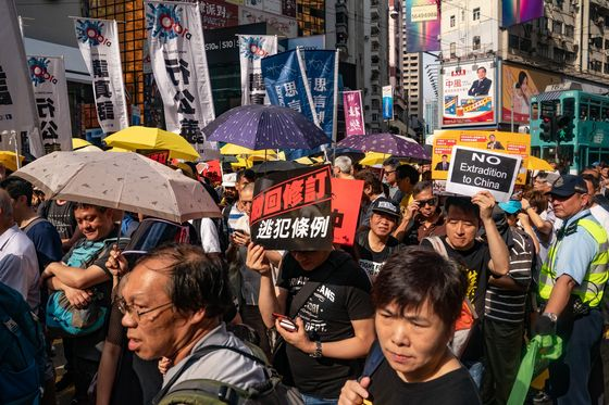 Hong Kong's Lam Defends Extradition Law After Thousands Protest