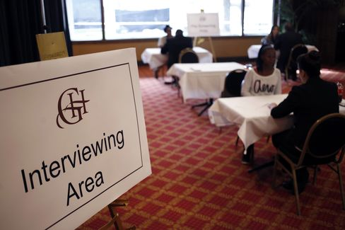 Job Seekers Meet with Recruiters during a Job Fair in Louisville