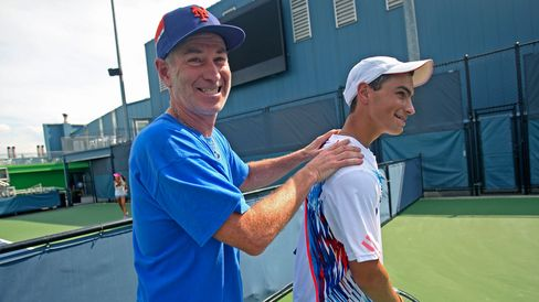 John McEnroe with 16-year-old Rubin at Sportime on Randall's Island in New York on Aug. 21, 2012.