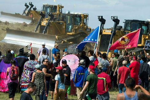 Demonstrators opposed to the pipeline confront bulldozers, on Sept. 3.