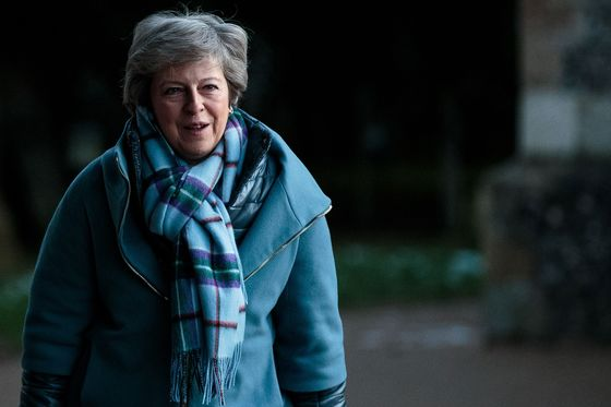 May Heads to Northern Ireland in Search for a Brexit Answer