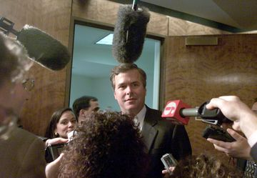 Governor Jeb Bush speaks to reporters at the Florida Capitol in Tallahassee on Nov. 16, 2000.