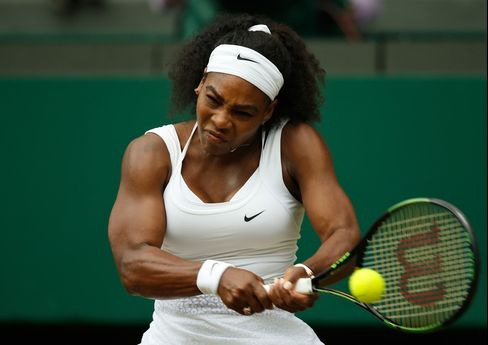 Serena Williams makes a return to Venus Williams, during their singles match against at the All England Lawn Tennis Championships in Wimbledon, London, on July 6, 2015.