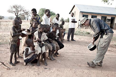 Power sharing the team's rice with children in the Ugandan village of Nyakumba