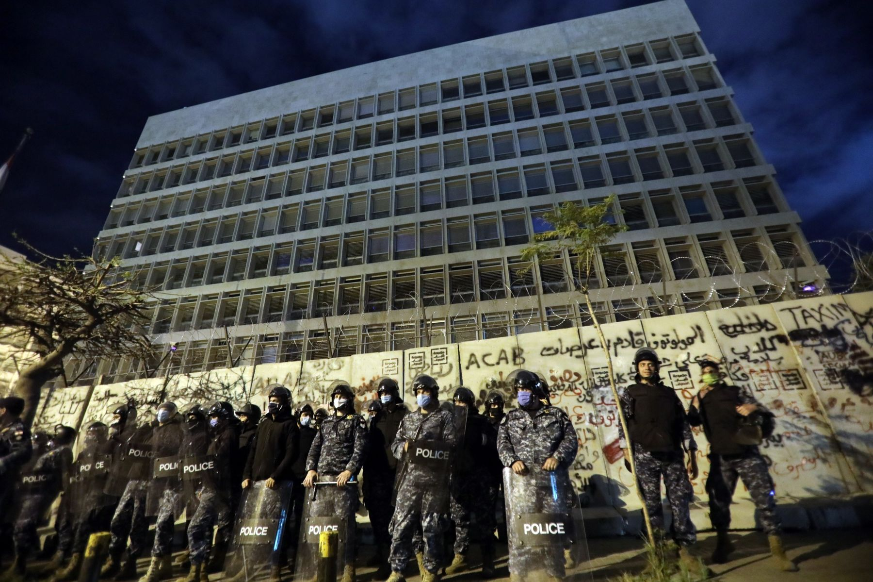 Police line up outside the headquarters of the Lebanese central bank during an anti-government demonstration in Beirut on April 28.