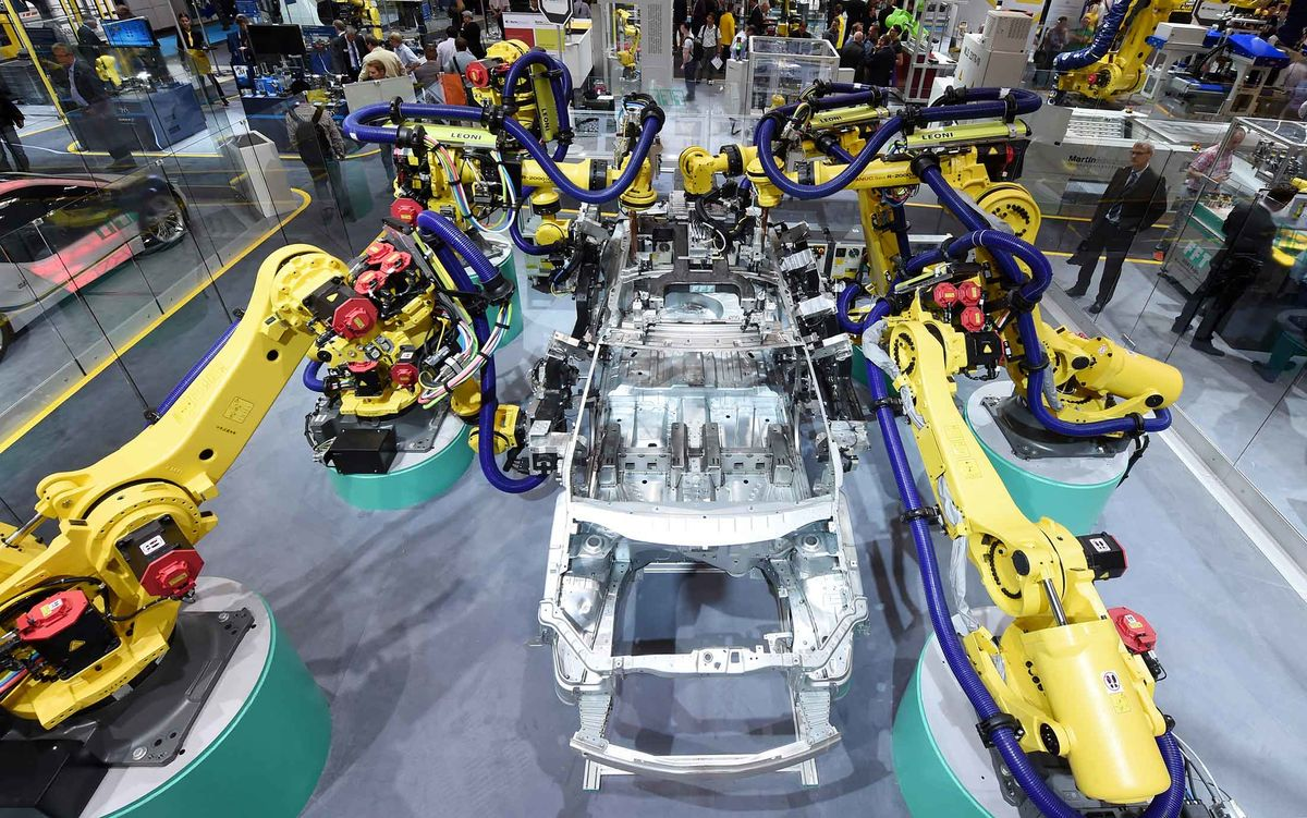 This Companys Robots Are Making Everythingand Reshaping The World Vw Control Arm Arms Low Price Leader Fanuc Simulate Car Production At Automatica Trade Fair In Munich 2016