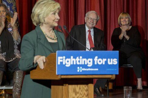 Warren Buffett and daughter Susan Buffett attend a Hillary Clinton campaign event at the Sokol Auditorium in Omah
