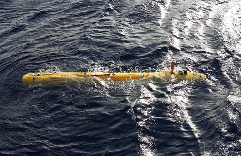 In this handout image provided by Commonwealth of Australia, Department of Defence, Phoenix Autonomous Underwater Vehicle (AUV) Bluefin-21 is in the water after being craned over the side of Australian Defence Vessel Ocean Shield to begin using its side scan sonar in the search for the missing Malaysia Airlines flight MH370 on April 14, 2014.