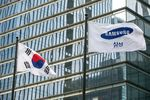 A South Korean flag, left, and Samsung Electronics Co. flag fly outside the company's headquarters in Seoul, South Korea.