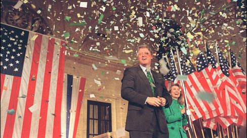 Democratic presidential candidate Bill Clinton in file picture dated 17 March 1992 in Chicago reacts with his wife Hillary as confetti reigns down during his victory party after winning the Illinois primary.