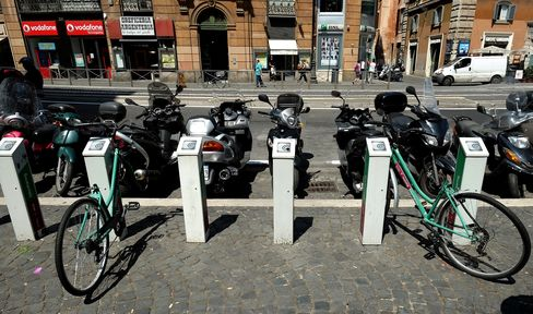 Scooters Park at Bike Sharing Bays in Rome