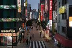 Pedestrians pass retail outlets in the Shinjuku District of Tokyo, Japan, on Monday, March 22, 2021. Japan ended the state of emergency in the Tokyo region Sunday, just days before the torch relay begins on March 25 for the virus-delayed Tokyo Olympics, now scheduled to start in July.