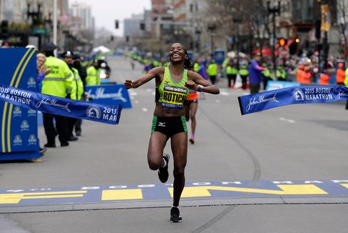 Caroline Rotich, of Kenya, breaks the tape to win the women's division of the Boston Marathon, on Monday, April 20, 2015 in Boston.