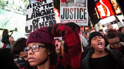 People protest in Times Square over the Ferguson grand jury decision to not indict officer Darren Wilson in the Michael Brown case November 25, 2014 in New York City.