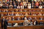 Pedro Sanchez, left, takes his seat in parliament in Madrid.