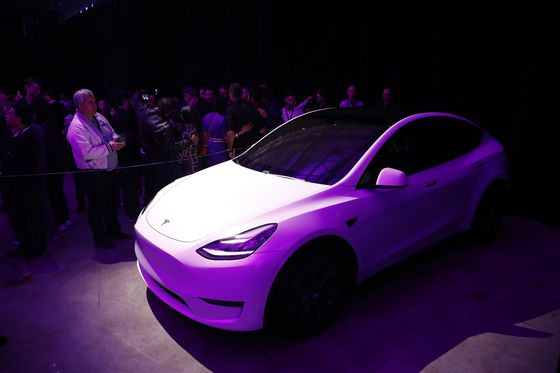 Tesla Shares Soar as ElonMusk Packs Profit Report With Positives