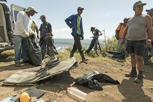 Volunteers gather next to large debris found on Reunion Island in August 2015.