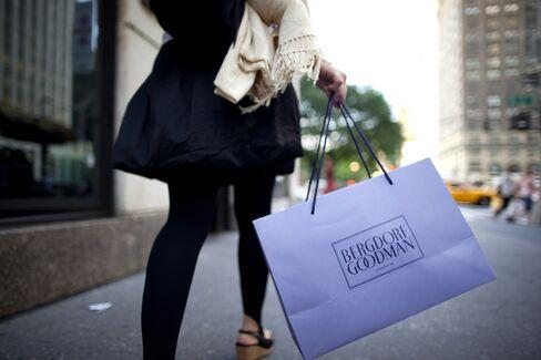 A Pedestrian Carries a Bergdorf Goodman Shopping Bag in New York